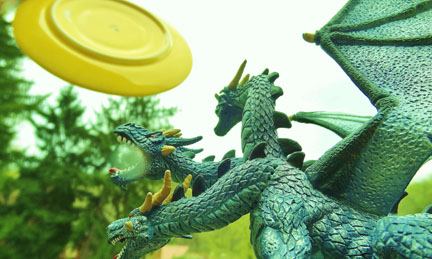 Dragon figure and a frisbee
